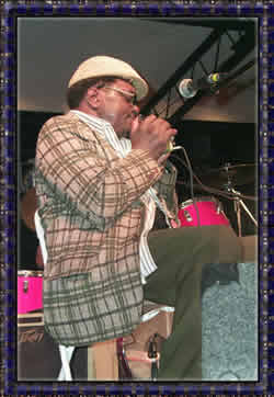 Mr. Arthur Williams blowin a mean harp